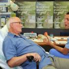 Anaesthesia specialist Jason Henwood (right) talks Jim Williamson through the benefits of...