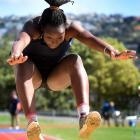 Atipa Mabonga (17), of the Otautau club, jumps during the women's triple jump on Athletics Otago...