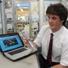 South Otago High School pupil Mitchell Hollows (18) shows off a prototype of his device, which...