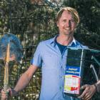 ''Dr Compost'' Ben Elms is ready to dig a bucketful of bokashi compost into his garden in Hawea...