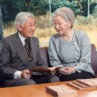 Japan's Emperor Akihito and Empress Michiko read a book at the Imperial Palace in Tokyo. Photo:...