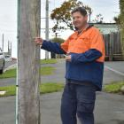 Eric Gotlieb is concerned about the safety of several power poles in his neighbourhood. Photo by...