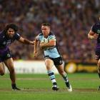 James Maloney on the run for the Sharks. Photo: Getty Images