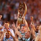Cronulla players celebrate with the trophy after their win over the Storm. Photo Getty