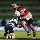 Waikato's Willis Haloholo tries to break the tackle of Ihaia West. Photo: Getty Images
