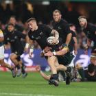 Halfback T J Perenara on the charge for the All Blacks against South Africa. Photo Getty