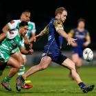 Otago's Matt Faddes makes a clearing kick against Manawatu. Photo Getty