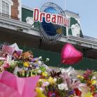 Tributes to the victims of the accident have been left at Dreamworld on the Gold Coast. Photo...
