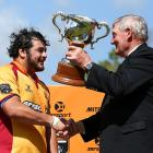 North Otago's Ralph Darling receives the Lochore Cup from Sir Brian Lochore after the game. Photo...