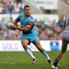 Jarryd Hayne looks to pass for the Titans this year. Photo: Getty Images