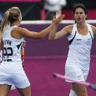 New Zealand's Kayla Sharland celebrates her goal with teammate Gemma Flynn. REUTERS/Dominic...