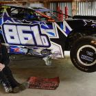 Ricky Boulton, of Milton, and his super saloon vehicle in his farm shed near Milton. Photo:...