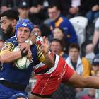 Otago second five-eighth Tei Walden tries to get past his opposite, Cardiff Vaega, at Forsyth...