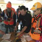 Searchers are issued with personal tracking devices as the Stewart Island training exercise...