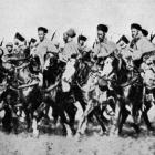 French colonial Spahi cavalry, from Algeria, on their swift Arab mounts are now being brought...
