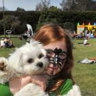 Katiya Brasell (6) with Cotton the dog at the Mornington Spring Picnic at Jubilee Park on...