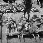 A scene at the rear of the trenches on the Somme: some of our wounded on stretchers, waiting for...