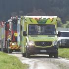 Emergency Services carry a man who injured his leg while whitebaiting on River Bank Rd, Henley on...