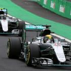 Mercedes' drivers Lewis Hamilton of Britain (44) and Nico Rosberg (6) of Germany drive during the...