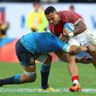 Tonga's Kali Hala runs the ball up against Italy. Photo Reuters