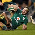 Iain Henderson scores the first try for Ireland against Australia. Photo Reuters