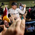 Nico Rosberg celebrates with his team after winning the Formula One world championship. Photo...