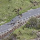 Earthquake damage is shown State Highway 1 north of Kaikoura. Photo: Getty Images