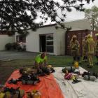 Ranfurly firefighters arrange gear outside the Maniototo Arts Centre after battling a fire. Photo...