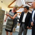 Cromwell Museum trustee Joan Lawrence (left) describes an old Cantonese headstone to Chinese...