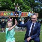 Tarras School pupil Billie Willson (10) high-fives Central Otago Mayor Tim Cadogan yesterday...
