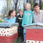 Louise, Jack, Briar and Reece Adamson examine unused beehives at their Earnscleugh home. Photo:...