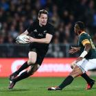 Ben Smith runs the ball up for the All Blacks against South Africa during their Rugby...