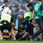 George Moala receives treatment for his injury during the match against Ireland in Chicago. Photo...