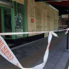 Boarded-up windows of a quake-damaged shop in Kaikoura's main shopping precinct. Photo: Chris...