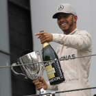 Lewis Hamilton on the podium after winning the Brazilian Grant Prix. Photo: Reuters