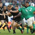 Owen Franks carries the ball for the All Blacks against Ireland in Chicago. Photo: Getty Images
