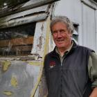 Warbirds over Wanaka volunteer Graham Taylor inspects an old caravan which could be part of one...