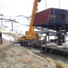 Contractors remove the McDougall ski lift drive station at the Cardrona Alpine Resort on Monday...