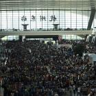 Passengers at a railway station in Hangzhou in September. Photo: Reuters
