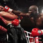 New Zealand heavyweight boxer Joseph Parker is hit by French Cameroon boxer Carlos Takam during a...