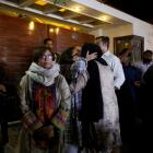 Relatives gather outside the residence of Junaid Jamshed, the pop star turned evangelical Muslim...
