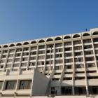 The hotel in Karachi, showing broken windows and the bed sheets used by guests to escape a deadly...