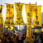 Protesters attend a rally demanding the impeachment of South Korean President Park Geun-hye in...