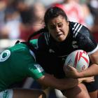 Shakira Baker of New Zealand is tackled by Lucy Mulhall of Ireland at the Emirates Dubai Rugby...