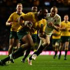 Australia's Sekope Kepu  charges towards the touch line during the match between England and...
