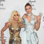 Model Gigi Hadid poses in the winners room with Donatella Versace after winning the International...