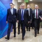 Israeli Prime Minister Benjamin Netanyahu (centre) arrives at the weekly cabinet meeting at his...