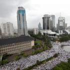 Indonesian Muslims gather in Jakarta to call  for the arrest of Jakarta's Governor Basuki Tjahaja...
