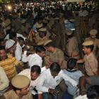 Police stop well-wishers as they gather outside the hospital in Chennai where  Tamil Nadu Chief...