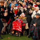 Prince Harry greets well wishers as he leaves the Christmas Day church service in Sandringham....
